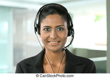 Pretty Indian call center employee. - Portrait of a happy...