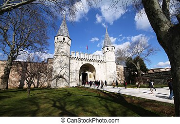 Topkapi Palace - Tourists go through the Gate of Felicity,...