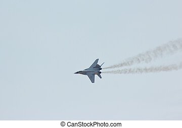 Flying russian military jet fighter MiG-29 make virage in...