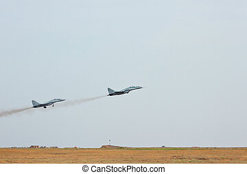 Two russian tactical jet fighter take off from the airfield
