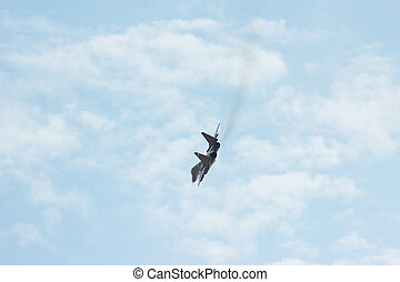 Flying tactical jet fighter MiG-29 make virage in the cloudy...