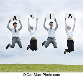 Asian man & woman jumping holding with a sign - Conceptual...
