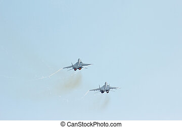 Two russian tactical jet fighter MiG-29 make maneuvers in...