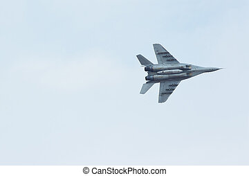 Russian tactical jet fighter MiG-29 in the cloudy sky