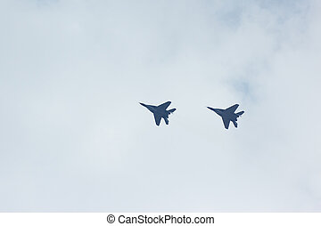 A squadron of two flying russian jet fighter MiG-29 in the...