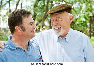 Father and Son Laughter - Senior father and adult son...