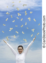 Its raining money - Conceptual Stock image of a woman...