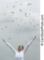 Its raining money - Conceptual Stock image of a man woman...