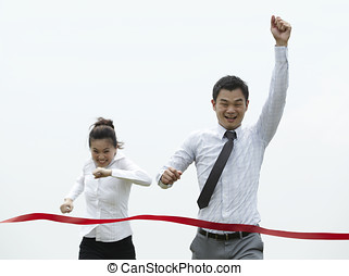 Winner! - Conceptual image of an Asian Business man winning...