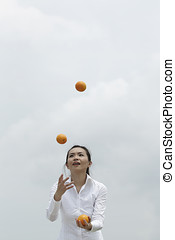 Asian Business woman juggling - Conceptual image of an Asian...