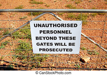 Warning sign on fence in Australia - Warning sign on fence...