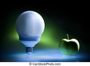 Enercy saving bulb and green apple, concept of green energy