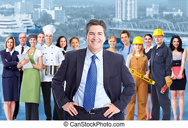 Businessman and Group of industrial workers. - Businessman...