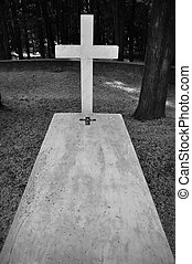 charnel ground - Cross and marble grave tombstone among...