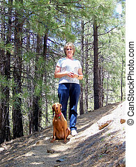 Woman and A Vizsla on Hiking Trail
