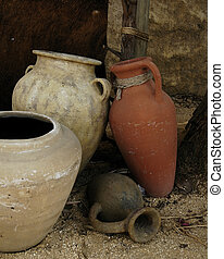 Ancient Pottery - Still life of four clay pots representing...