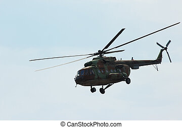 Russian military helicopter MI-8 make maneuvers in the...