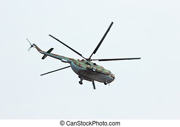 Russian flying military helicopter MI-8 make virage in the...