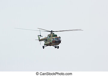 Russian flying military helicopter MI-8 make maneuvers in...