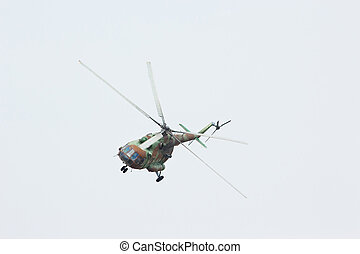 Russian military helicopter MI-8 make virage in the cloudy...