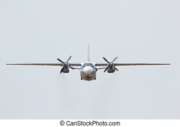 Russian military transport aircraft AN-26 in the cloudy sky