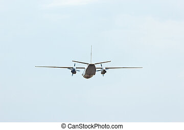 Russian military transport airplane AN-26 in the cloudy sky