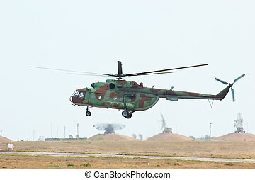 Russian military transport helicopter MI-8 is landing on the...