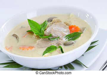 tom kha - close up view of nice delicious Thai soup on white...