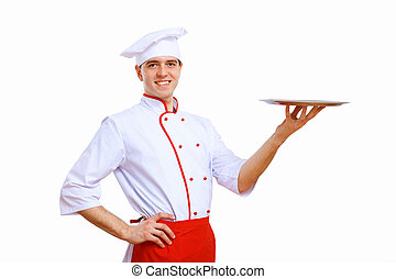 Cook holding an empty tray - Male cook in uniform holding an...