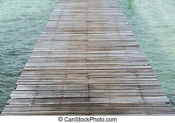 Wooden walk path on the water