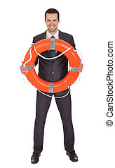 Young businessman with life buoy