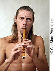 Musician - A man playing his wind instrument with expression