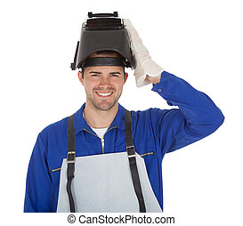 Portrait of confident young welder Isolated on white