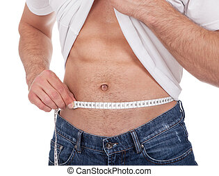 Muscular man measuring waist - Muscular young man measuring...