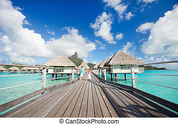 Over the water bungalows - Two kids walking towards over the...
