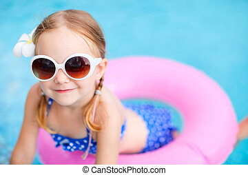 Little girl at swimming pool - Adorable little girl with...