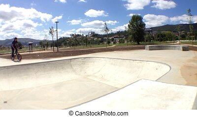 BMX bike stunt in skateboard park - BMX bike stunts in...