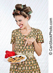 Woman Winks As She Holds Plate Of Cookies - Portrait of...