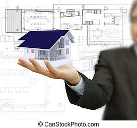 house model and plan on touch screen - Businessman present...