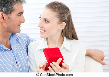 Couple Holding Box Ring