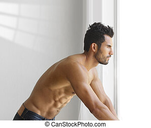 Young muscular man - Portrait of a thoughtful handsome...
