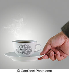 hand and a cup of coffee with brain sketch as concept