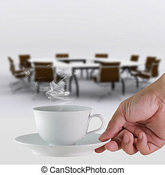 coffee cup in hand business and meeting room background -...