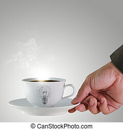 hand and a cup of coffee with light bulb drawing as concept