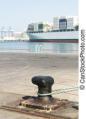 Ship moored to pier, view from the bollard