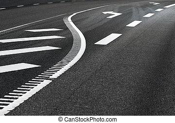 Asphalt road with arrow sign