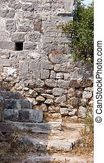 Loophole on the stone wall for rifle fire on ruin of castle...