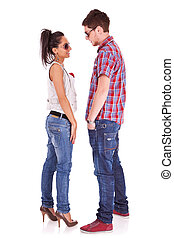 cute casual couple standing face to face - Full length...