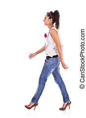casual woman walking - side view of a casual woman walking...