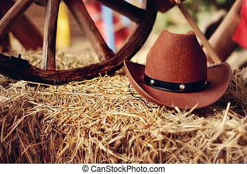 cowboy's hat - on a haystack the brown cowboy's hat and a...